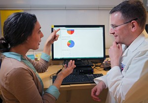 Data manager, Nicole Matthews and Scott Simon, M.D., assistant professor of neurosurgery